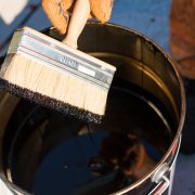 indestructible paint in a can with a brush