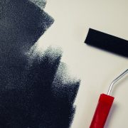 applying liquid rubber coating on a wall with a roller