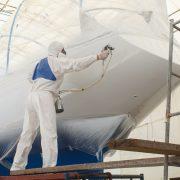 Applying marine coating in dry dock