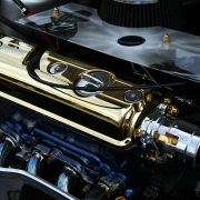 golden automotive powder coating on a car engine