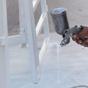 applying polyurethane coatings with a spray gun in white